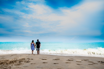 This couple is enjoying some quality time by the beach during their pre-wedding shoot.