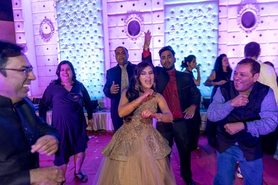 The bride setting the dance floor on fire with her killer moves!