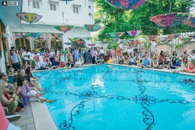 Pool side mehendi ceremony held at Samode Palace, Jaipur.
