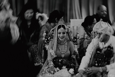 Bride and groom following the rituals of the wedding ceremony
