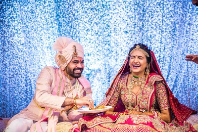 candid couple photography in the mandap as the ceremony progresses