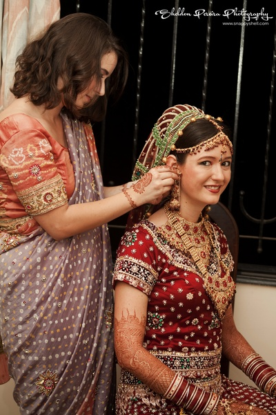 Bride decked in jewellery for the wedding ceremony