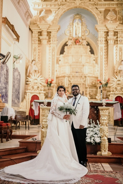 The bride and groom complementing each other extremely well during their church wedding.