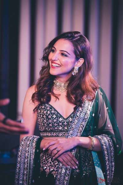 A beautiful candid capture of the bride at her sangeet ceremony