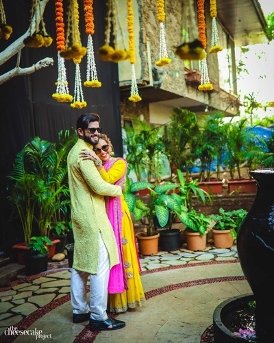 The bride and groom pose for The Cheesecake Project before their haldi ceremony!