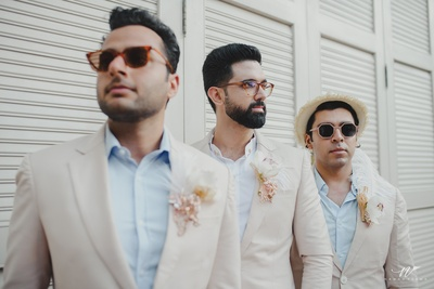 the bridesmen decked in sky blue and beige