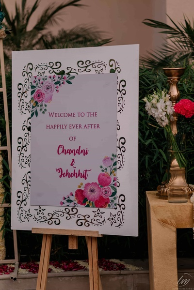 A beautiful signage at Chandni and Ichchhit's wedding.