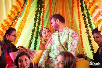 Bride and groom posing with their friends in a candid capture