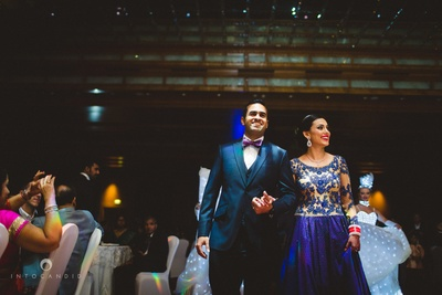 Bride and groom entering their wedding reception .