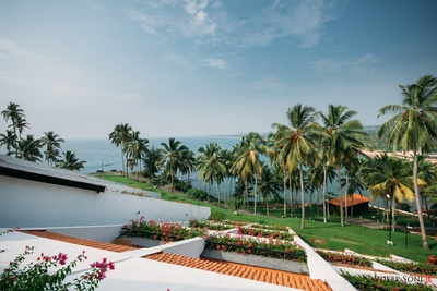 Scenic view of the grand Leela with lush green lawns and an endless view of the ocean