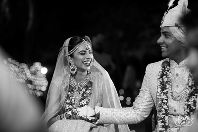 Black ad white portrait of the bride and groom at the wedding mandap