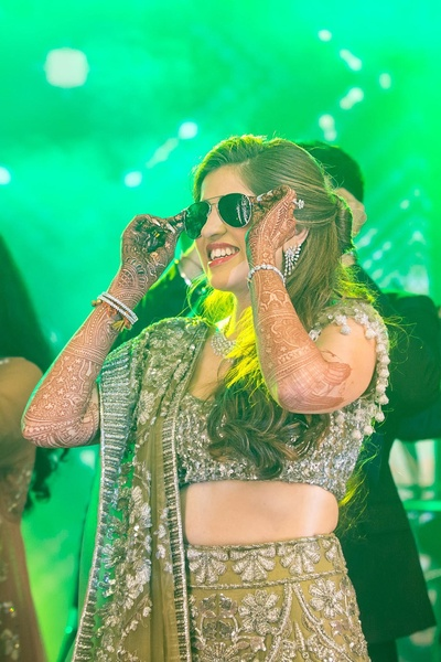 The bindaas bride flaunts her sunglasses in style during a dance performance.