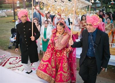 The bridal entry under a beautiful phoolon ki chadar
