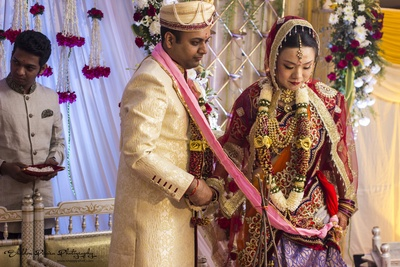 Bride's dupatta adorned with ornamented ends