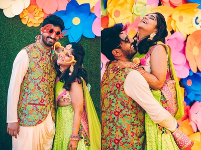 Bride and Groom dressed up in colour coordinated outfits for the mehendi ceremony.