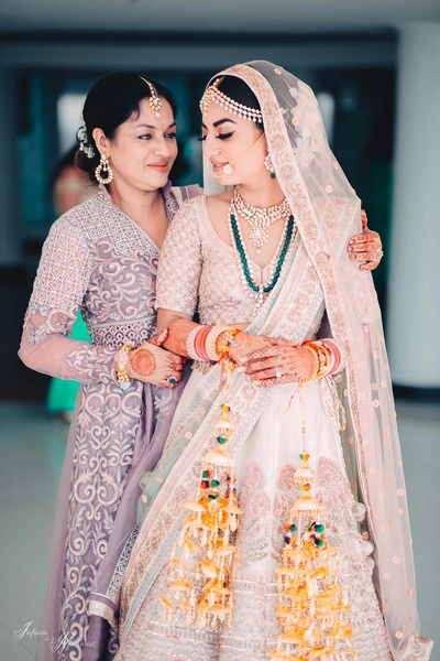 Candid wedding photo of the bride and her mother before the wedding ceremony