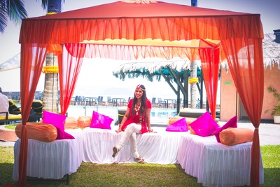 Coral and fuchsia themed outdoor haldi decor for the haldi function