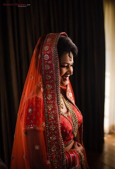 bridal portrait shot in her red wedding lehenga