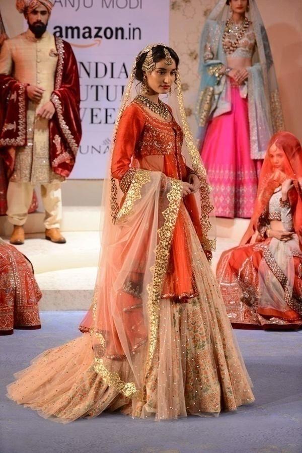 Orange bridal lehenga by designer Anju Modi