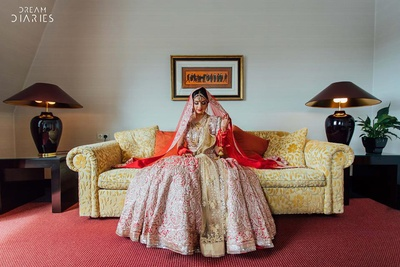 Dressed up in a regal red and silver heavy embroidered lehenga by Manish Malhotra for the wedding day.