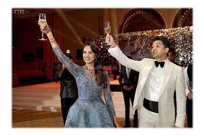 Bride and groom raise a toast during their reception