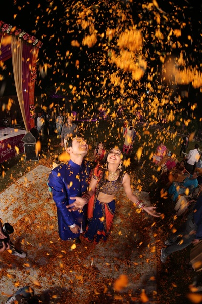 Candid wedding photo shoot with a shower of Marigold flower petals