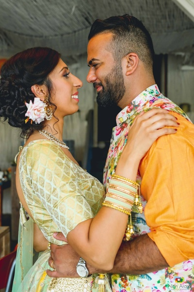 Candid capture of the bride and groom in their coordinated bridal trousseau