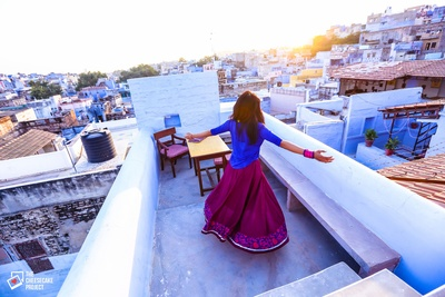 Dressed in dark blue kurti and sheer flared skirt to match the backdrop of  pre wedding photo shoot in the blue city of Jodhpur