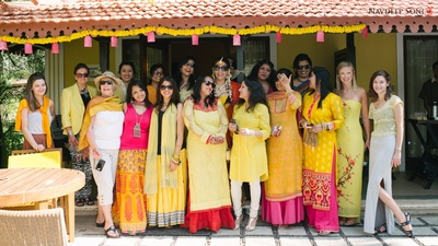Bridal party decked and dolled up in hues of yellow and pink for the fun-filled Haldi ceremony