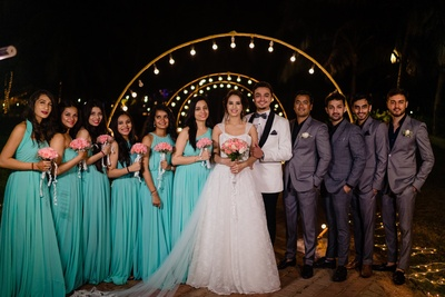 the couple with the bridesmaids and groomsmen at the engagement ceremony