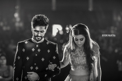 candid black and white capture of the couple at their engagement