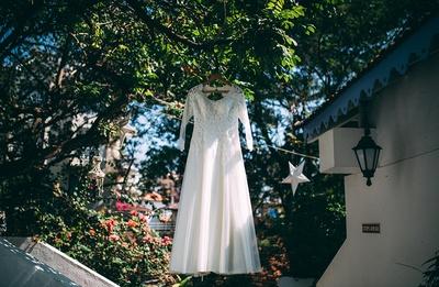 White full-sleeves sheered wedding dress embellished with embroidered bodice