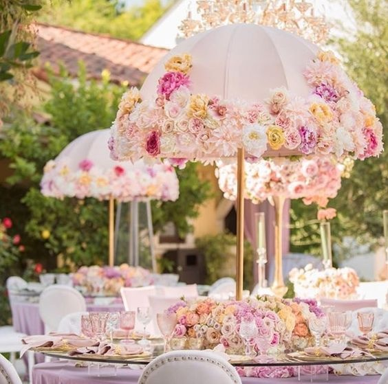 8 cool ways to use umbrellas as decor at your indian wedding blog transparent umbrellas brimming with colourful flowers look so beautiful if you cant get your hands on transparent ones not a problem junglespirit Image collections