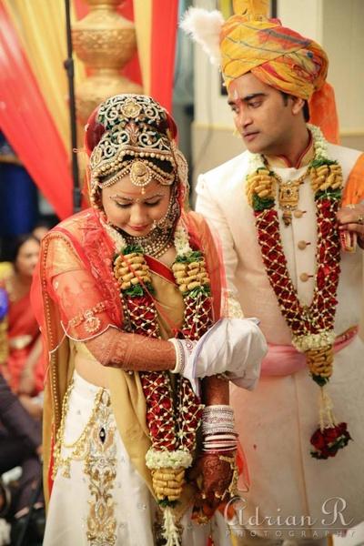 Bride and groom taking saath phere