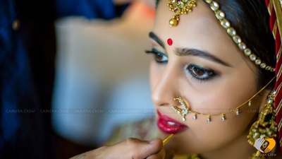 Final touches of diamond studded nose ring makes the bride look majestic