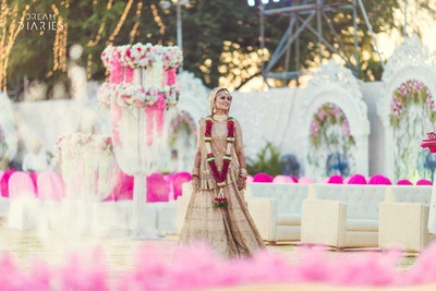 Bride posing in her wedding lehenga after jaimala