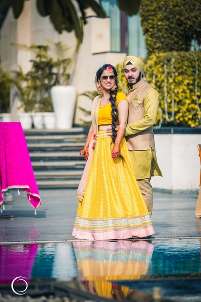 traditional bride and groom on their mehendi day