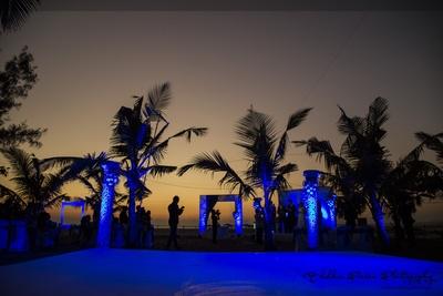 Outdoor blue-hued wedding reception venue