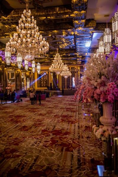 Opulent wedding decor- chandeliers, floral arrangements, and more...