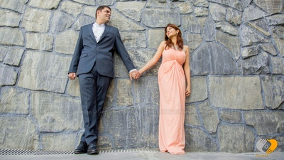 Couple dressed in peach and blue outfits for their destination wedding shoot