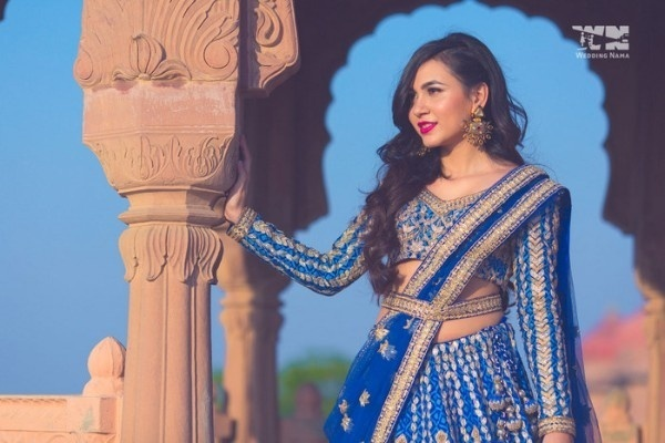 16. Royal Blue Lehenga With Golden Motifs All Over