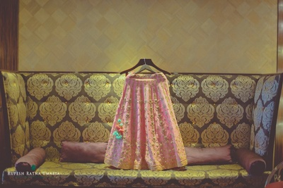 Blush pink wedding lehenga embellished with zari motifs, sequins and embroidery