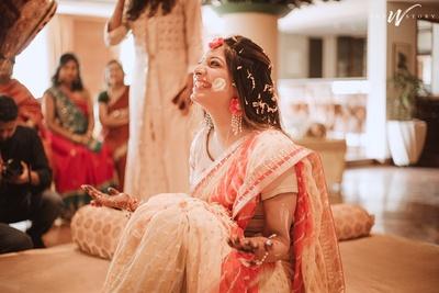 the happy bride at her haldi ceremony