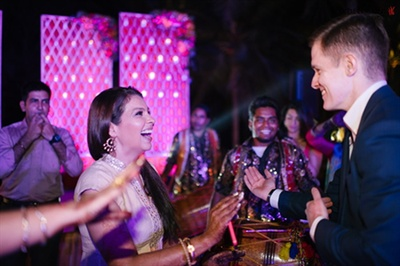 The couple dancing at their sangeet