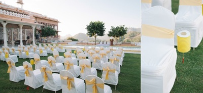 Outdoor nuptial ceremony held at Fatehgarh, Udaipur with white chair covers and gold tie backs and yellow embellished hangings