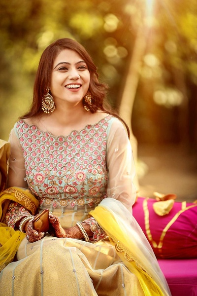 Bridal portrait captured by Dipak Studios during the mehndi ceremony