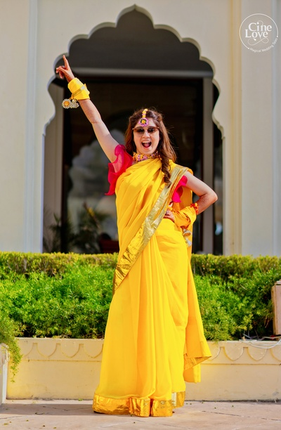 We are drooling over this bindaas bride in bright yellow and pink!