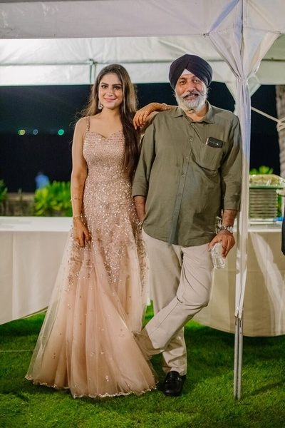 Bride with her father at their cocktail party