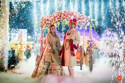 Candid picture of the bride and the groom after the jaimala ceremony
