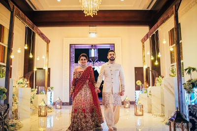 Cute couple making a grand entry to their sangeet ceremony